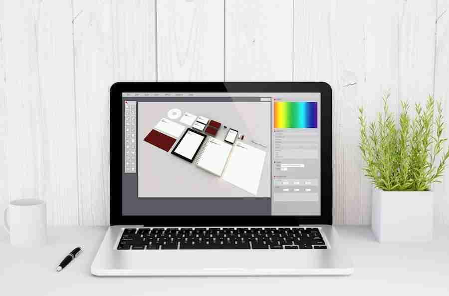 laptop on table branding design